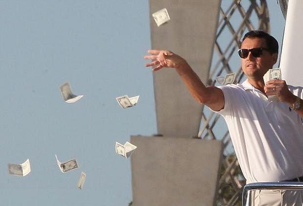 Leonardo DiCaprio throwing money